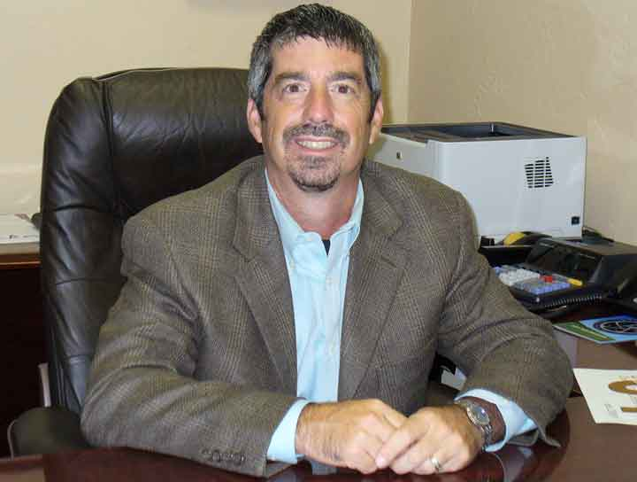 James Serio, CPA sitting at desk